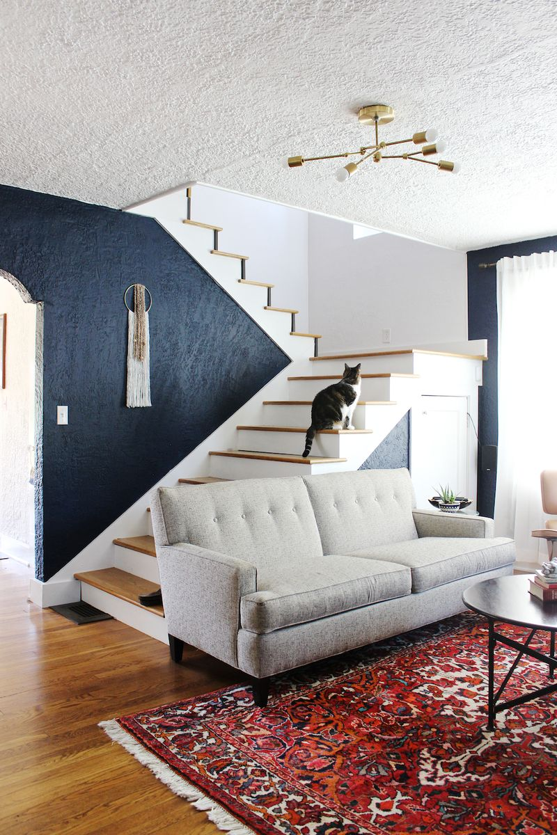 White Stairwell With Black Walls Interior Design Mag