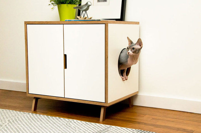 Dresser with access for the cat from modernistcat.