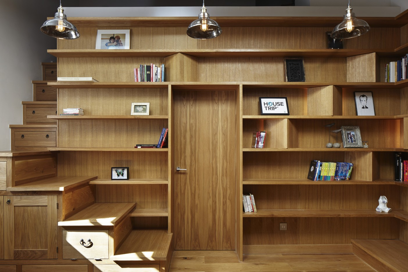 Library with embedded staircase interior design mag for Bachelor apartment vs studio