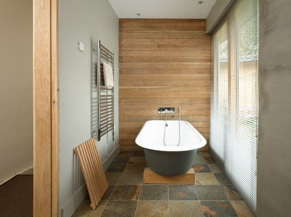 A bathroom with a garden view