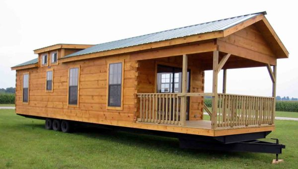 Back of a truck turned into a log cabin