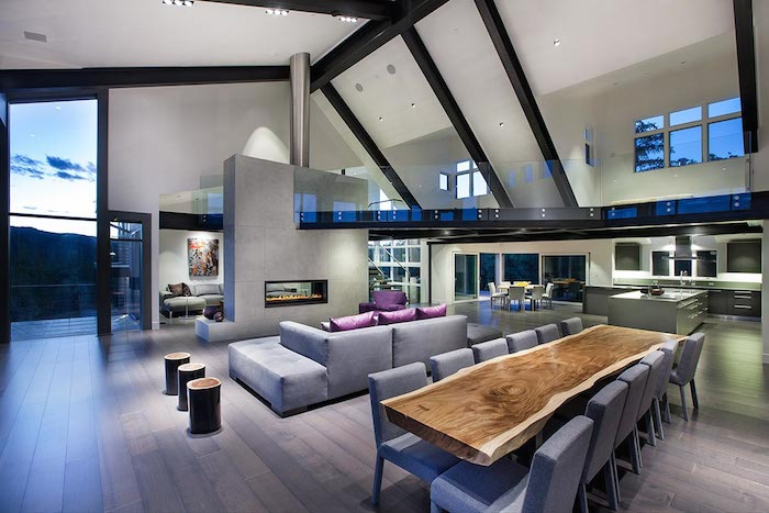Contemporary Living room with slanted ceiling and huge