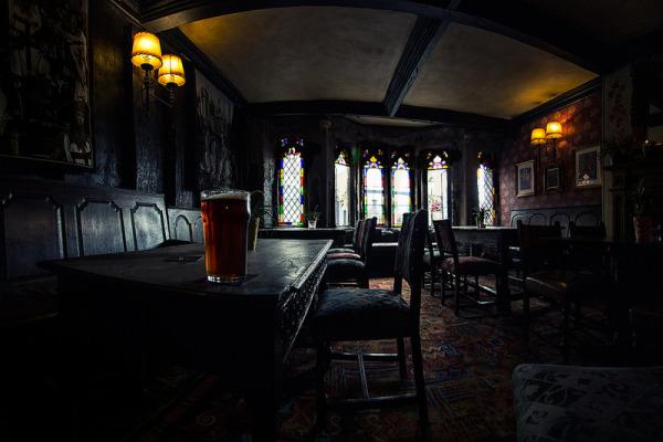 Darkly gothic bar with Arthurian theme. - The George & Pilgrims - Glastonbury, England