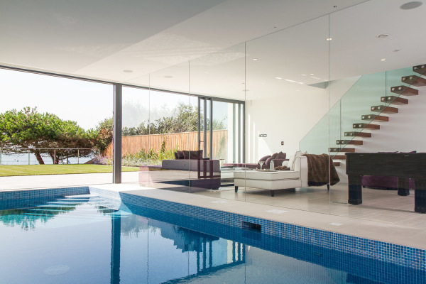 Indoor pool and living space, all on the waterfront at Sandbanks, Dorset, UK