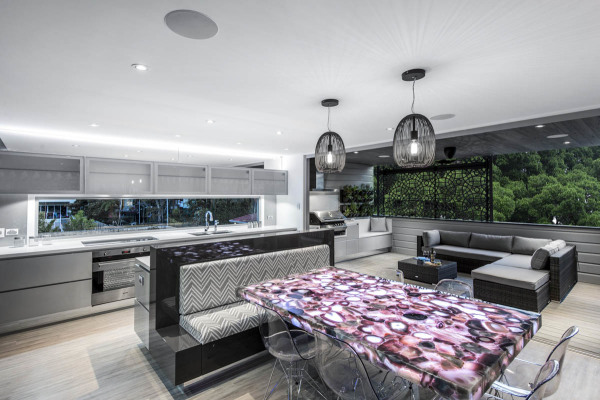 Open plan living area with backlit geode (quartz) dining table