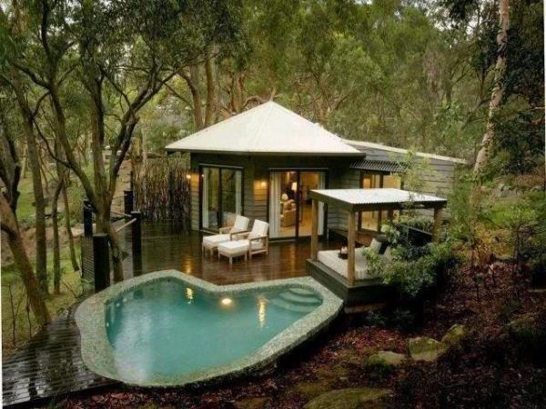 Outdoor bedroom with a pool