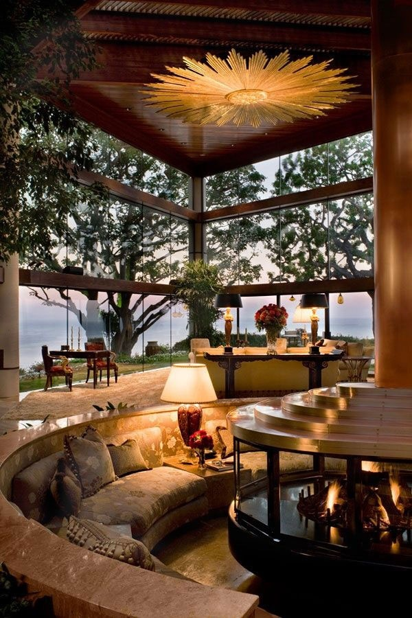 Conversation pit around a fireplace with a beautiful view