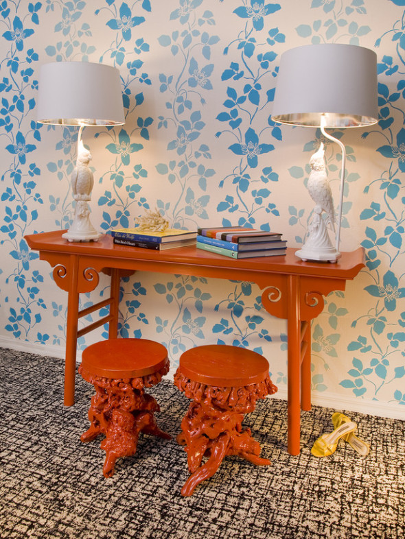 Asian Inspired Home Office with Vibrant Blue Floral Wallpaper and Orange Tables