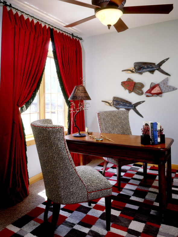 Playful Home Office with Cheetah Print Chairs and Red Drapes