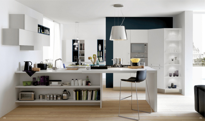 Kitchen island with a table and work surface.