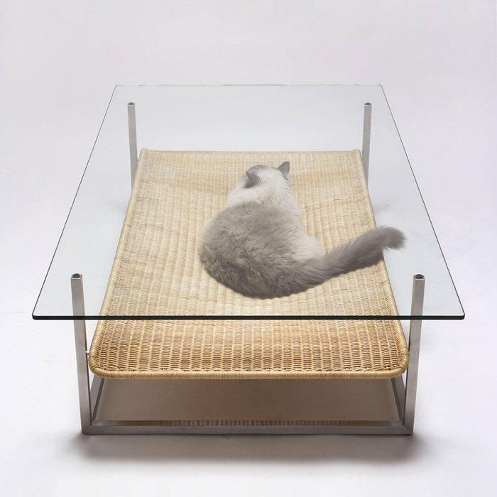 Coffee table with a hammock by Koichi Futatsumata.